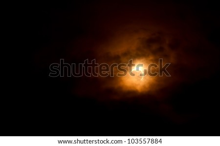 Solar eclipse, photos of moon covering the sun with light cloud cover. May 20, 2012