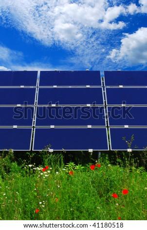 Solar energy panel on a green meadow