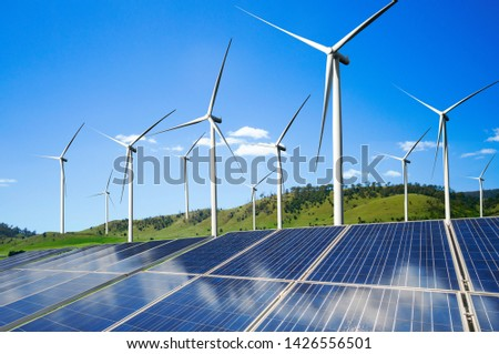 Solar energy panel photovoltaic cell and wind turbine farm power generator in nature landscape for production of renewable green energy is friendly industry. Clean sustainable development concept. ストックフォト ©