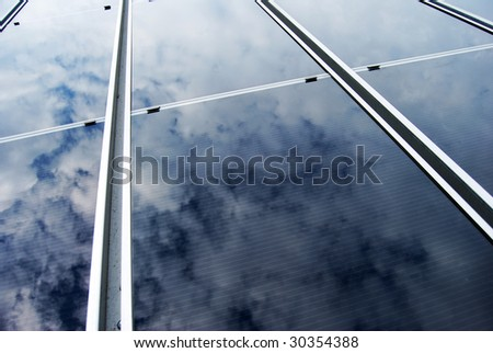 Solar energy panel with cloud reflection
