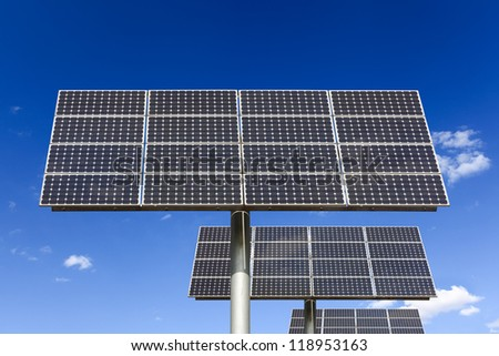 solar energy panels against a blue sky