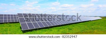 Solar energy panels against blue sky.