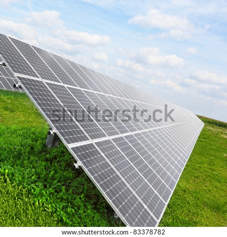 Solar energy panels against blue sky.