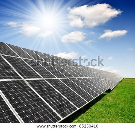 Solar energy panels against sunny sky - stock photo