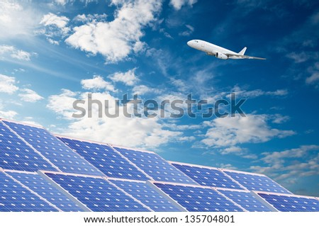 Solar energy panels and airliner. Alternative energy concept.