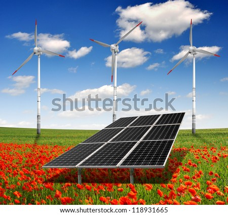 solar energy panels and wind turbine on the poppy field