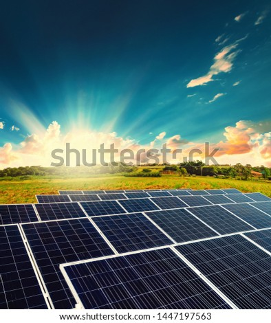 Solar energy power plant over a beautiful sundown sky #1447197563
