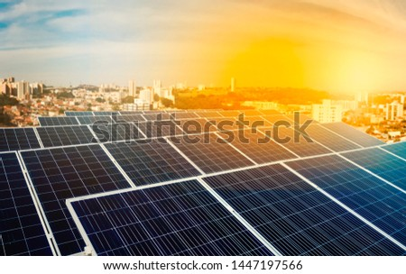 Solar energy power plant over a beautiful sundown sky #1447197566
