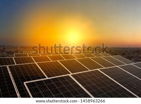 Solar energy power plant over a beautiful sundown sky. #1458963266
