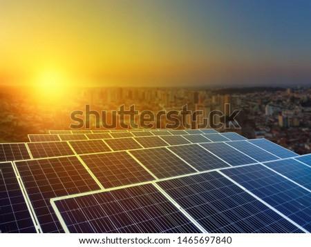 Solar energy power plant over a beautiful sundown sky #1465697840