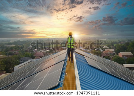 Solar energy Steel Roof Truss Construction Construction Worker Installing New Roof Roofing Tools Power Drill Apply to New Roof with Metal Sheet