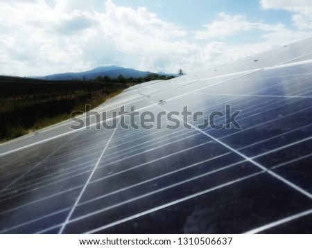 Solar Ennergy with nature background #1310506637