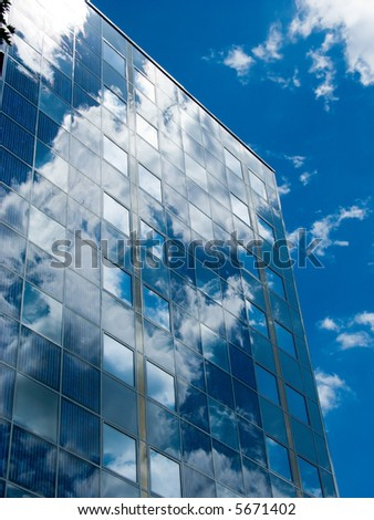 Solar facade with cloud reflections