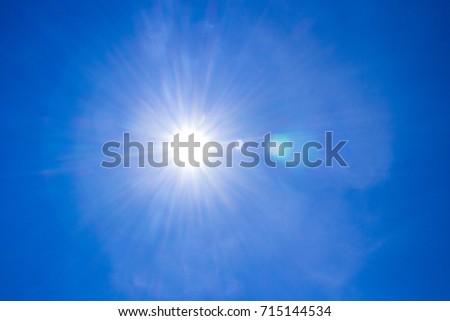 Solar lens flare Sunlight shines  in the sky.      #715144534