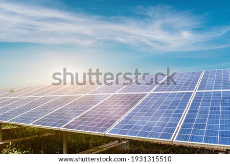 Solar panel against blue sky background. Photovoltaic, alternative electricity source. Idea for sustainable resources Stockfoto ©