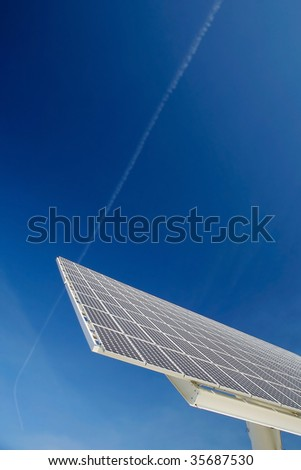 Solar panel against blue sky. Good for issues such as renewable energies, air pollution, global warming.