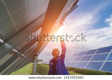 Solar panel, alternative electricity source, concept of sustainable resources, And this is a new system that can generate electricity more than the original, Technician checking Solar panel.