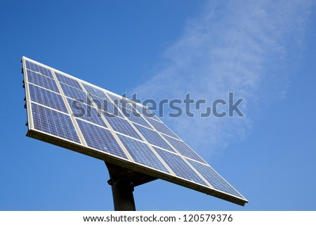 solar panel and blue sky with clouds that look like steam