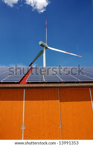 Solar panel and pole with a wind turbine