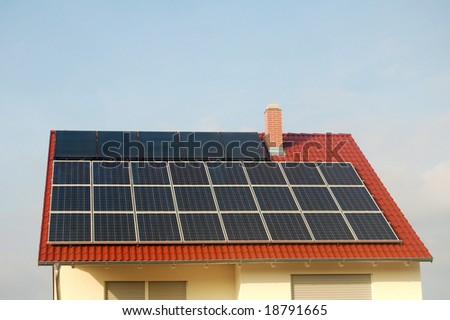 Solar panel and solar energy panel on a red roof