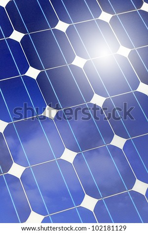 Solar panel (cell and battery) detail and closeup with sky and sun reflection