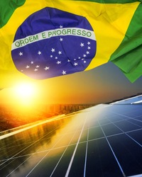 Solar panel Concept Image. Photovoltaic plant with brazilian flag at sunset.