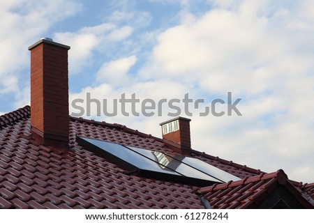 Solar panel on a roof cloudy sky