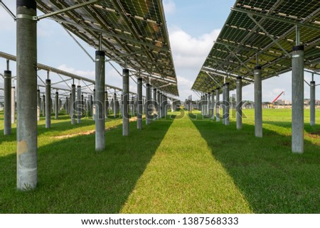 Solar panel on green grass isolated on white background #1387568333