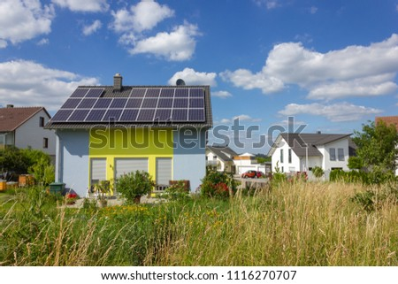 solar panel on rooftop of south german rural village at springtime near city of stuttgart #1116270707