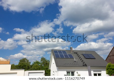 solar panel on rooftop of south german rural village at springtime near city of stuttgart #1116270749