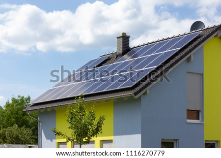 solar panel on rooftop of south german rural village at springtime near city of stuttgart #1116270779