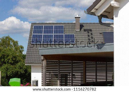 solar panel on rooftop of south german rural village at springtime near city of stuttgart #1116270782