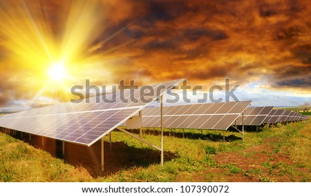 Solar panel produces green, enviromentaly friendly energy from the setting sun