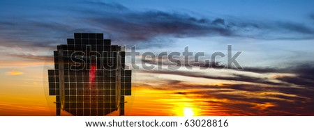 Solar panel receiving sunlight at sunset