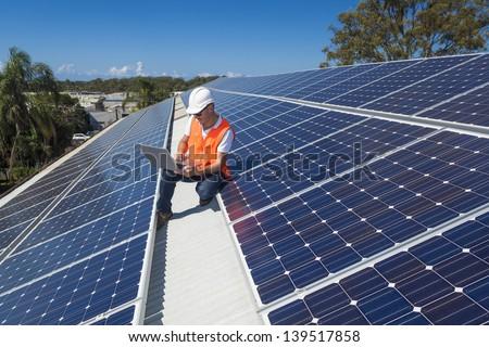 Solar panel technician on roof #139517858