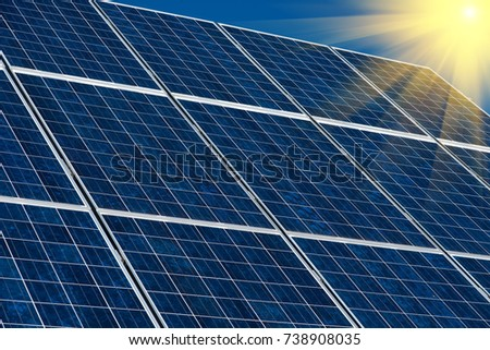 Solar panels against a blue sky background. Concept of Nature Conservation. #738908035