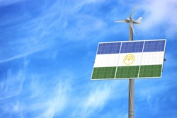 Solar panels against a blue sky with a picture of the flag of Bashkortostan