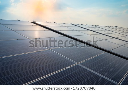 Solar panels and blue sky background.Solar cells farm on the roof.Photovoltaic modules for renewable energy.Save the earth and the energy with good environment concept. Stockfoto ©