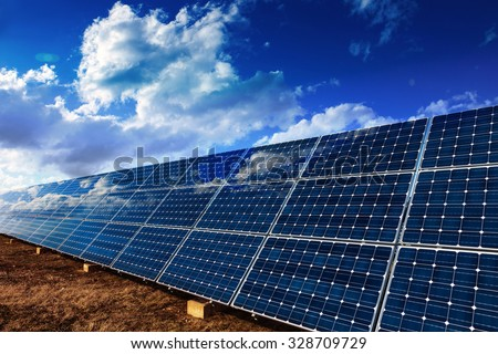 Solar panels and cloudy sky background #328709729