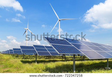 solar panels and wind turbines generating electricity in power station green energy renewable with blue sky background