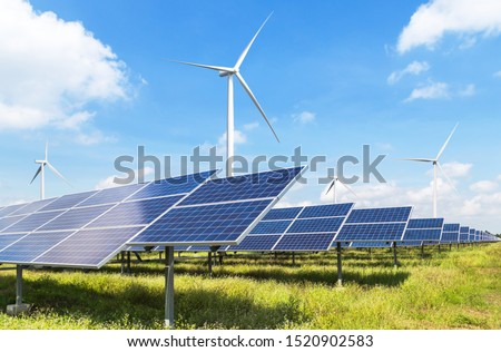 Solar panels and wind turbines generating electricity is solar energy and wind energy in hybrid power plant systems station use renewable energy to generate electricity with blue sky