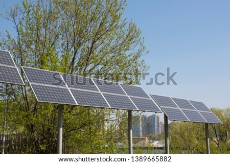 Solar panels are installed in the city park. Environmental Protection