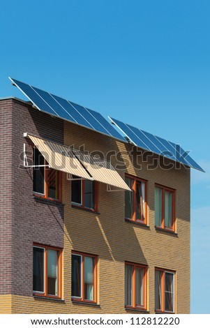 Solar panels attached on the front of a newly build European house