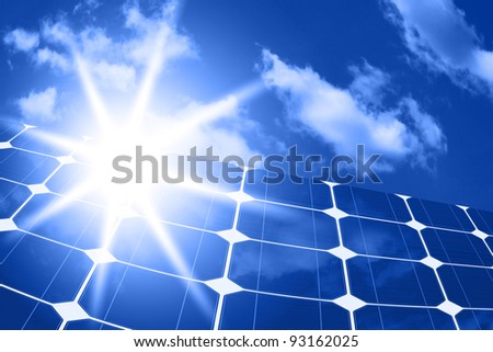 solar panels - clean energy source on the background of sky and bright sun