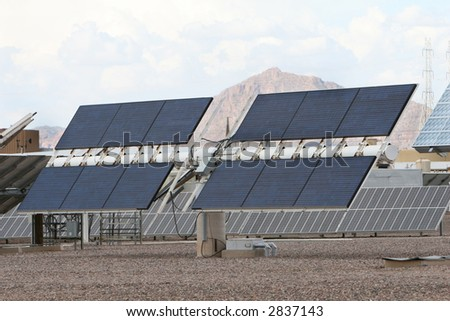 Solar panels in front of desert mountains in Arizona. Good for issues about power, air pollution, global warming, etc.