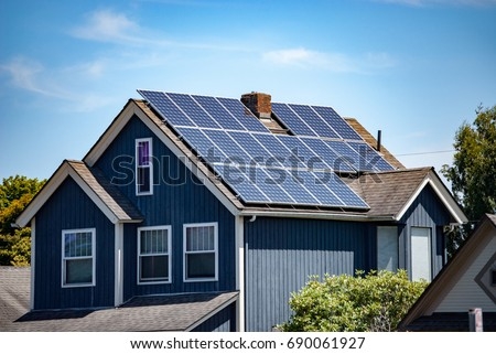Solar panels installed and in use on roof of home #690061927