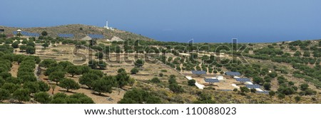 Solar panels near olive trees. Crete landscape. Greece