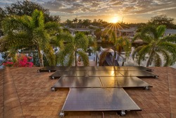 Solar panels on a residential house in Florida as the sun is rising.