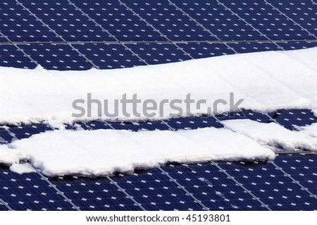 solar panels on a roof in winter with snow