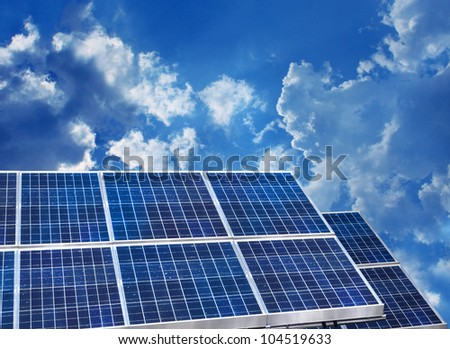 Solar panels on blue sky background